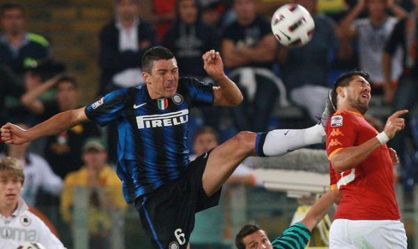 Lucio, of FC Internazionale Milano, kicks Marco Borriello of AS Roma in the head during the Serie A football match at Stadio Olimpico.