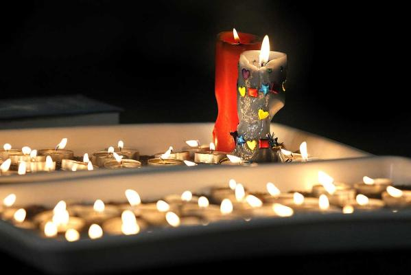 REMEMBRANCE: Burning candles at Holy Trinity Anglican Church during a candlelight vigil in Greymouth.