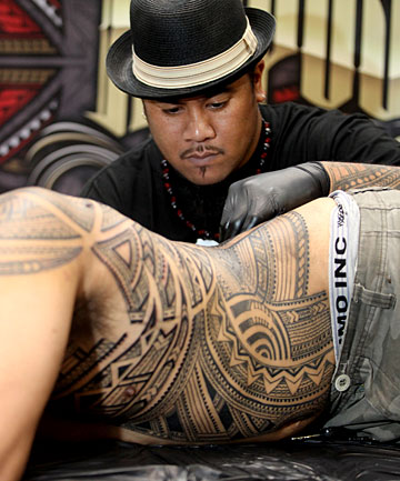 TATTOO TRADITION: New Plymouth artist Andy Tauafiafi makes an addition to