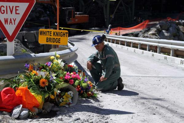 Miner lays down flowers.