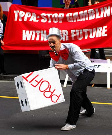 TRADE GAMBLE: A protester outside the Grand Hotel in Auckland where free trade talks are being held.