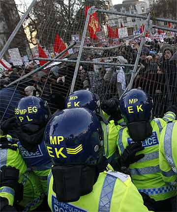 FEE DEMONSTRATION: Protesters had earlier pushed over metal barriers and occupied the square opposite parliament in Westminster.