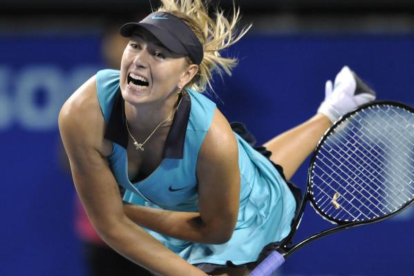 Maria Sharapova serves against Kimiko Date Krumm during their women's singles first round match at the Pan Pacific Open tennis tournament in Tokyo in 2010.
