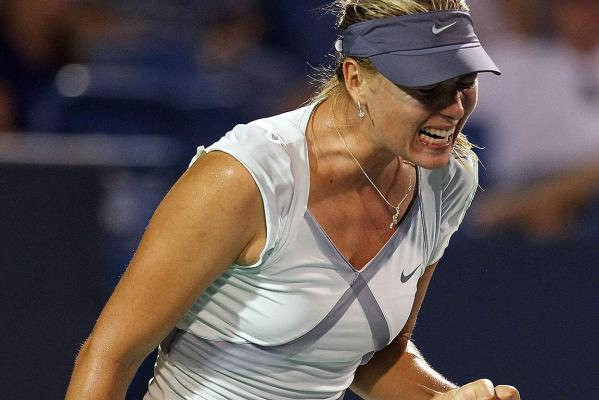 Maria Sharapova reacts after winning a point against Svetlana Kuznetsova during day two of the Western & Southern Financial Group Women's Open in 2010.