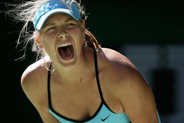 Maria Sharapova celebrates after she won a point during an Australian Open tennis tournament quarterfinal match in Melbourne in 2006.