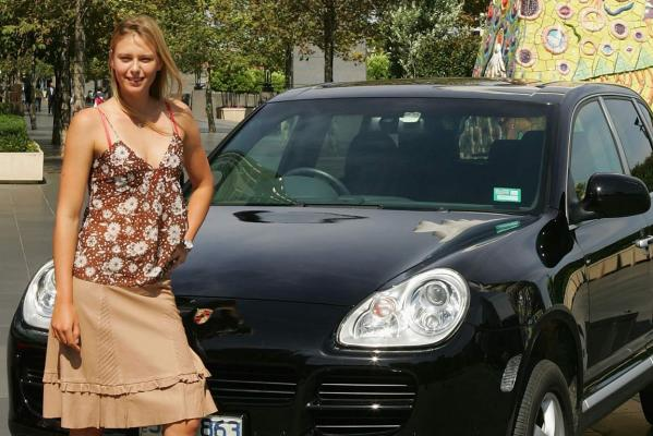 Maria Sharapova poses for a photograph after donating the value of a Porsche won at the 2004 WTA Tour Championships to charity during the Australian Open Grand Slam at Melbourne Park in 2005.
