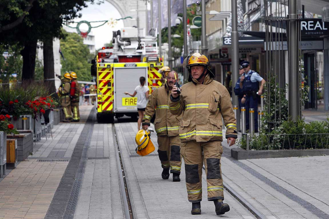 Firefighters and police close off Cashel Mall after the quake.