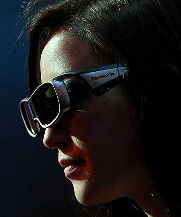 A woman wears 3-D glasses while watching a television during the 2010 CES event in Las Vegas.