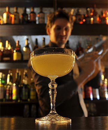 RISKY: Bar Manager Nicolas de Soto mixes a Calvados-based coc