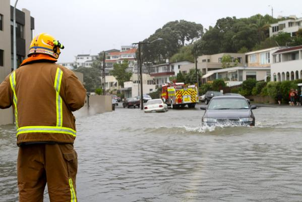 A motorist drives through water along Kohimarama Road in Auckland.