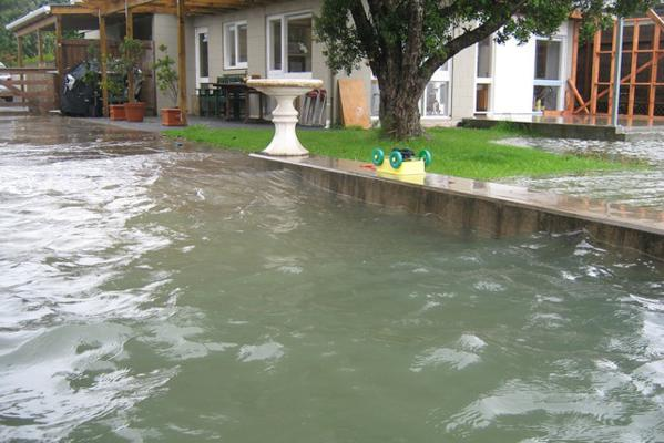 Waterfront homes at Herald Island in West Auckland have been hit by the floodwaters.