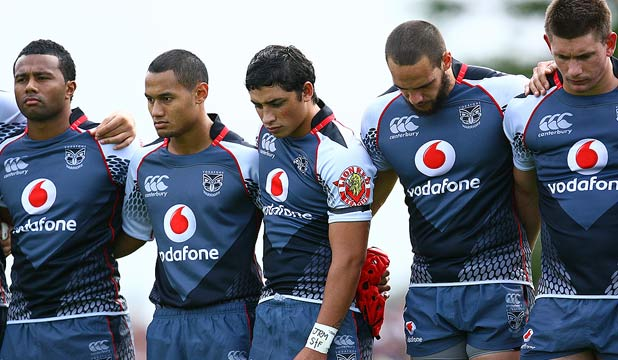 NZ Warriors players observe a minutes silence before their trial match against the Newcastle Knights in Greymouth.