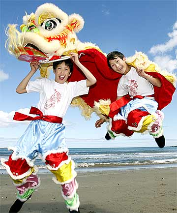 ROARING TO GO: Rory and Jasper James will be taking part in chinese festivities this weekend.