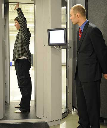 CONTROVERSIAL: Transportation Security Administration employees demonstrate new body scanner software at Washington's Reagan National Airport.