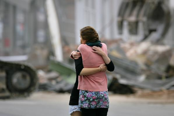 Martine Ribotton is comforted as her place of work is demolished