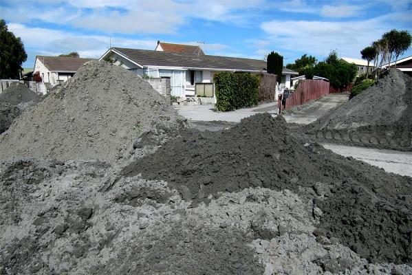 Piles of dirt from liquefaction build up as the clean-up gathers pace.