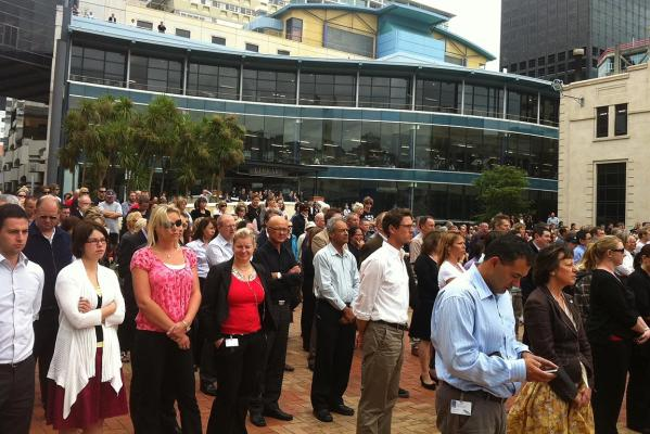 People gather to observe two minutes' silence in commemoration of the victims of Christchurch's earthquake at Wellington's Civic Square.