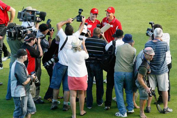 Media scrum at Fill the Basin for Christchurch