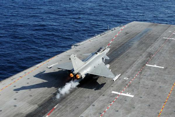 A Rafale fighter jet makes a catapult launch from France's flagship Charles de Gaulle aircraft carrier. The carrier, carrying a crew of around 100 and some 20 air