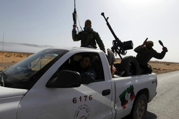 Rebels travel in a convoy on their way to Sirte city near Bin Jawad.