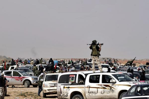 Libyan rebels gather near Nofilia, 100km from Sirte.