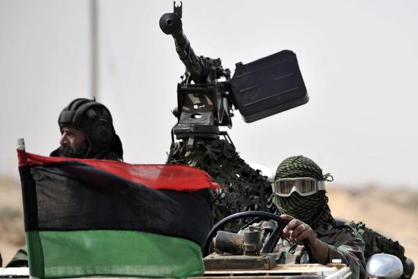 Libyan rebels return from the battle field outside the oil rich town of Ras Lanuf.