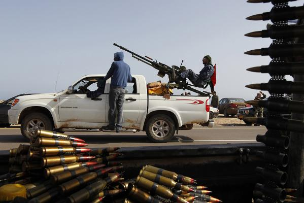 RETREAT: Libyan rebels drive back to Bin Jawad.