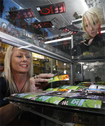 RESTOCKING: Dizzzy Spells owner Megan DeVries, watched by Amy Stephenson, says she has to restock with 