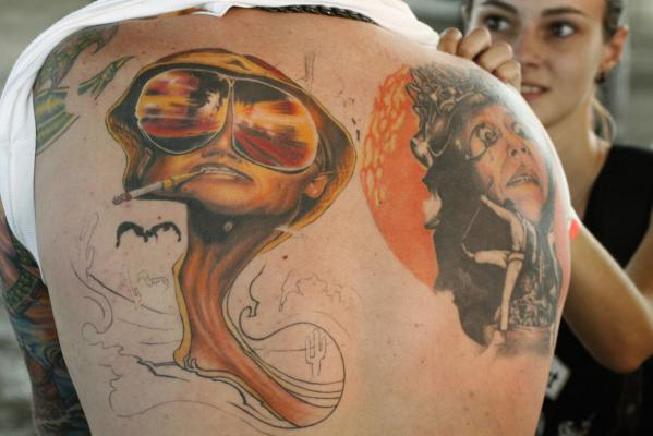 A man shows his tattoo at the first Tattoo Expo in Moscow in 2007.