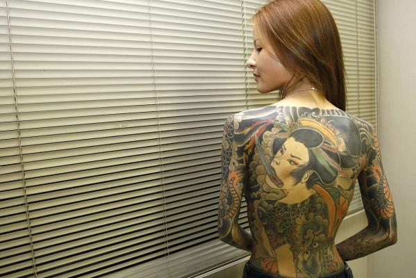 Shoko Tendo author of Yakuza Moon poses after an interview with Reuters in Tokyo in 2007.