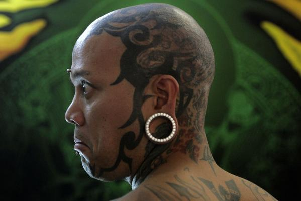 Tattoos are seen on the head of a man at the International London Tattoo Convention in 2007.