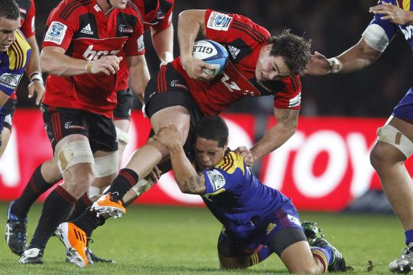 Zac Guilford of the Crusaders is tackled by Aaron Smith of the Highlanders during the round 10 Super Rugby match at Trafalgar Park in Nelson.