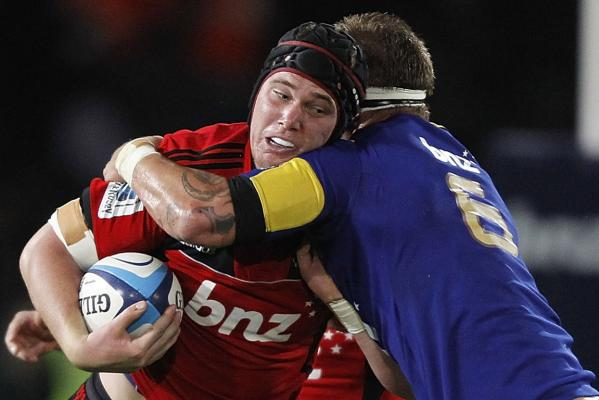 Matt Todd of the Crusaders is tackled by Jarrad Hoeata of the Highlanders during the round 10 Super Rugby match at Trafalgar Park in Nelson.