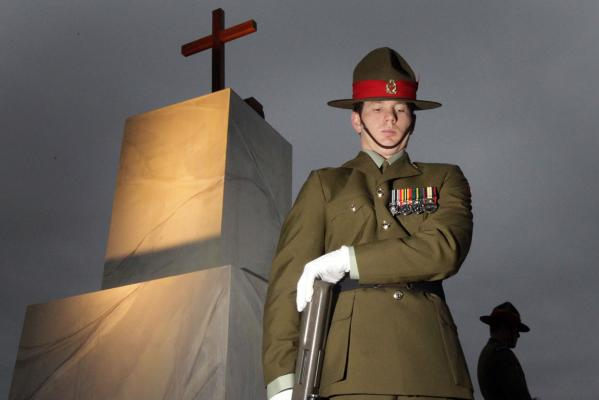 Anzac service in Christchurch's Hagley Park. Cross made from wood from the Christ Church Cathedral by Au