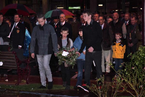 Anzac Dawn Sevice at Feilding - Carrying the O'Donnell family wreath to lay on the cenotaph are from left; Cameron Charlton-Smith, Ben Farmer, Thea Rogers and Liam Farmer.