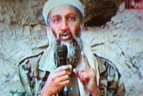 Osama bin Laden is seen at an undisclosed location in this television image broadcast October 7, 2001 from Al Jazeera Television in Qatar.