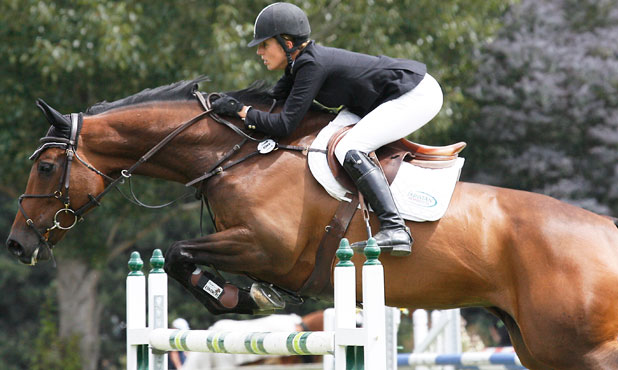 Katie McVean competing on Dunstan Delphi in the NZ Show jumping championships at McLeans Island in this file photo.
