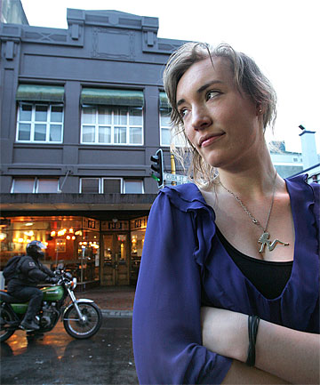 FINAL NOTICE:  Ernesto cafe staffer Marie Groenendijk is unconcerned that she works in a building deemed earthquake-prone.