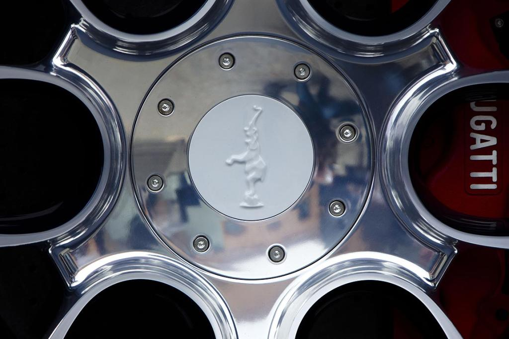 The porcelain application on a wheel of a unique version of a Bugatti Veyron Gran