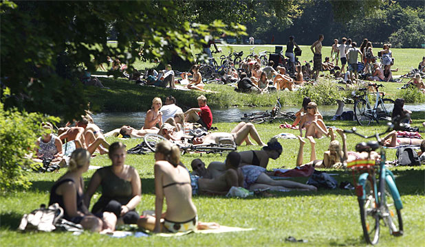 COVERED UP: Mostly clothed people relax in Munich's English Garten park. The naked sunbathers who once crowded Germany's Baltic beaches and city parks are becoming an endangered species.