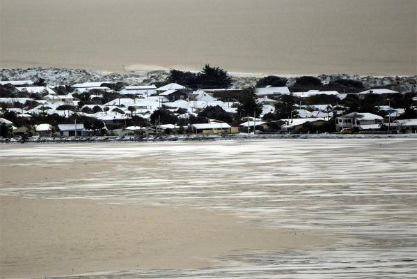Redcliffs and Moncks Bay were covered down to the beach with a thick coating of snow.
