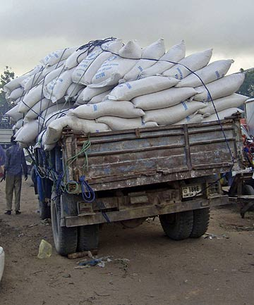 A truck delivers stolen food aid to a market at the former water agency in the Somali capital Mogadishu.