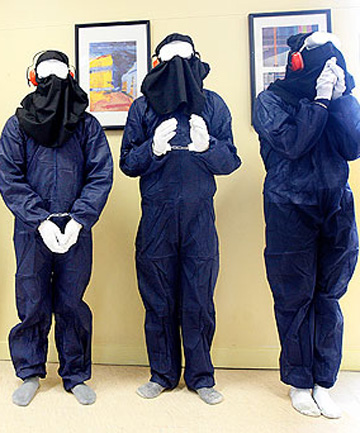 KENT BLECHYNDEN/Dominion Post  CRUEL AND UNUSUAL? Wellington High School teachers and pupils dressed as Guantanamo Bay prisoners line up for the school to raise awareness.