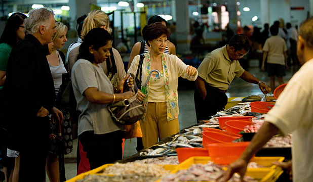 MAKE WAY: The queen of Nyonya cuisine, Florence Tan, centre, is revered  in Melaka's markets.
