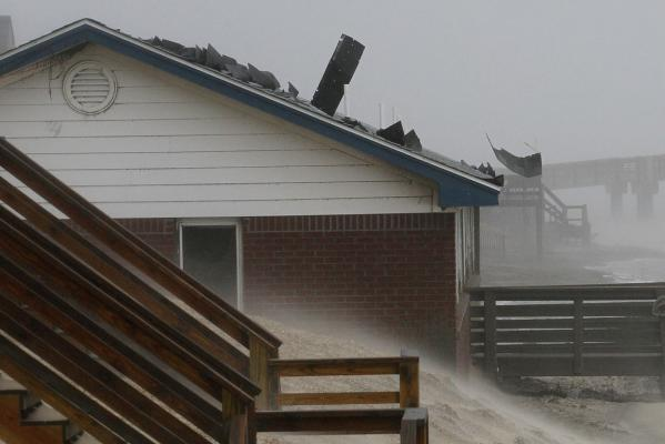 Shingles are torn from rooftops as the effects of Hurricane Irene are felt in Nags Head, North Carolina, in the US.