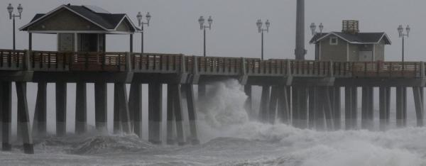 Waves crash under Jeannette's Pier as the effects of Hurricane Irene are felt in Nags Head, North Carolina, in the US.