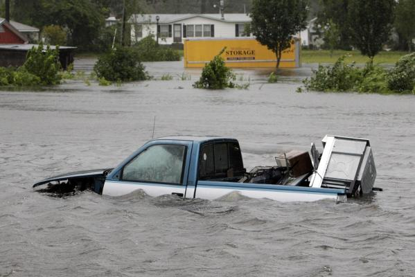 Floodwaters surround this pickup truck on Hwy 55 in New Bern, North Carolina as Hurricane Irene hit the US.
