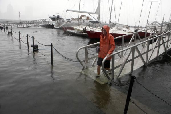 Harbourmaster Arjen Weehuizen walks along the inundated docks of Battery Park City's North Cove Marina as Tropical Storm Irene passes through New York.