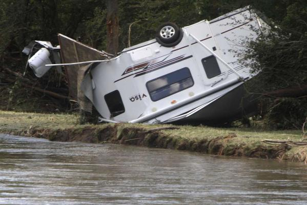 A caravan lies upside down on a riverbank in Berlin, Vermont, after it was washed away by flash flooding following heavy rains from Tropical Storm Irene.