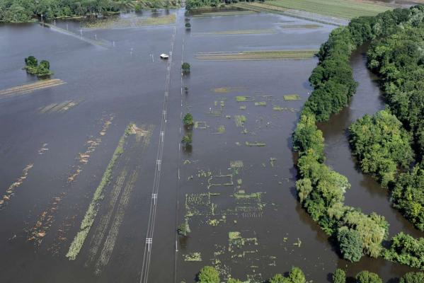 Flooding over a road from the Farmington River is seen in the aftermath of Tropical Storm Irene, in Simsbury, Connetticut.